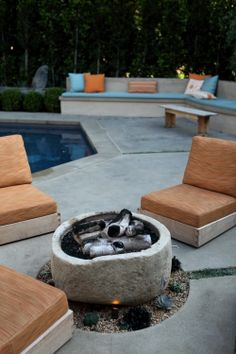 Lounge seating at firepit with built ins in the background.