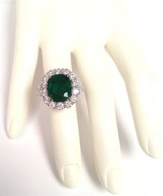 Cushion Shape 8.62 Carat Emerald Diamond Platinum Cocktail Ring | From a unique collection of vintage three-stone rings at https://www.1stdibs.com/jewelry/rings/three-stone-rings/