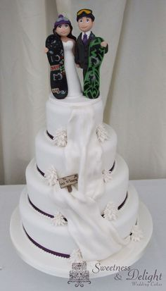 Snowboarding themed wedding cake -repinned from Los Angeles County, California wedding minister https://OfficiantGuy.com