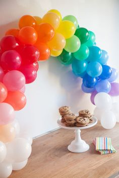 Mini Rainbow Balloon Arch DIY. Rainbow fun for kids birthday parties and decorating with balloons.