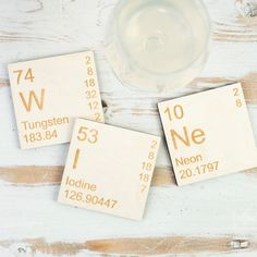 Rest your drink on the periodic table with these wooden elements chemistry coasters. Christmas stocking filler science gift for geeks and wine lovers. These natural wood coasters come in sets to spell out words using the periodic table of elements. This set of three make for a unique place to rest your glass of WINe. Great gift for her. The full choice of coaster sets includes: TeA, LaDy, OK, OMg, BeEr, Au-Pt, WINe, BOsS and CaFFeINe. Packaging: Each set comes in a cleave sleeve with a sp...