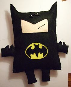 Felt Batman doll. I bet you could enlarge this and use something softer to make it into a pillow
