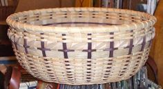 "I can't remember the name of this basket but it was taught by Claudia Leo in northern Virginia. It was fun though I never got all the curls done (weaver kept cracking). This was donated to a silent auction at work to raise funds for the Combined Federal Campaign. They put bath items in it (to ""add"" to the prize) which I thought totally ruined it..but live and learn."
