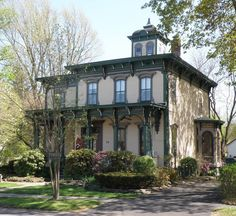 House Styles: 1840 - 1885: Italianate House: Victorian Italianate homes usually have flat or low-pitched roofs and large brackets in the eaves.