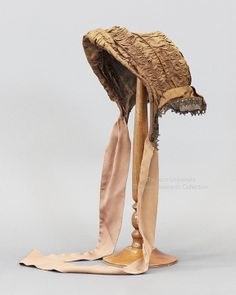 Victorian brown ruched silk bonnet with brown lace trim. No label. c.1880s FRC1993.05.013