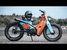 """Then 'Joey Boy,' the Thai Rap star, told custom shop K-Speed what he wanted. """"Can you build me a Honda Super Cub scrambler? Joey had seen a previous… Honda Cub, C90 Honda, Honda Bikes, Honda Motorcycles, Custom Motorcycles, Custom Bikes, Triumph Scrambler, Motorcycle Design, Motorcycle Bike"""