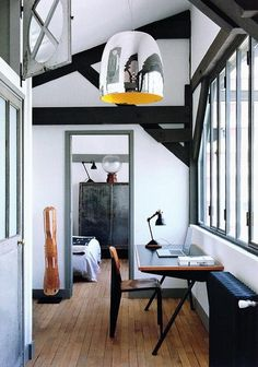 Simple work space at a window. Love the pendent light.