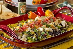 This all-in-one chicken dish features flavorful yellow rice ,veggies, beans, and chopped chicken. It's a dinner recipe the whole family will enjoy.