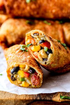 Crispy Baked or Fried Southwest Egg Rolls loaded with Mexican spiced chicken, beans, tomatoes, rice, avocado and melty cheese with Cilantro Lime Ranch Dip!