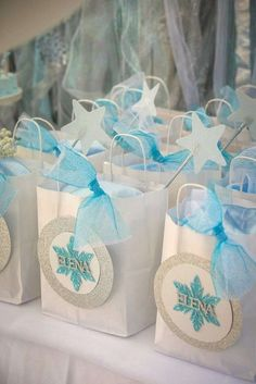 Pretty snowflake bags at a Frozen birthday party! See more party planning ideas at CatchMyParty.com!