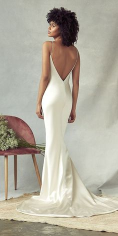Signature style silky, champagne bias cut V neck slip wedding dress. The skirt is elegantly cut with side godet detailing to give further volume to dramatic train. Feel the aesthetic of Hollywood while looking effortlessly romantic in this gown. Slip Wedding Dress, Best Wedding Dresses, Satin Mermaid Wedding Dress, Backless Wedding Dresses, Silk Wedding Gowns, Mermaid Bridal Gowns, Simple Elegant Wedding Dress, Simple Bridesmaid Dresses, Wedding Bouquets