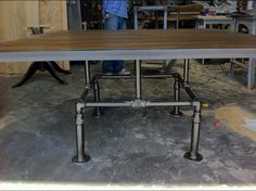 reclaimed wood and plumbing pipe table