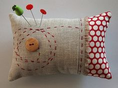 . . . pinning all the totally fun pincushions I find, as if I actually have a need for more than I already use :)