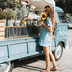 The chicest farmers markets we have ever seen! How cute is this little flower truck?