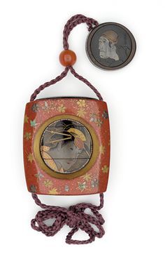 Inrō: lacquer on substrate, mixed metal flecks; Ojime: carnelian; Netsuke: shakudo disk, engraved and inlaid in silver and copper honzogan, bamboo bowl; kagamibuta type, Head of an Actor, signed Sharakuga