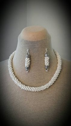 Check out this item in my Etsy shop https://www.etsy.com/listing/465511465/white-fashion-necklace-and-earrings-set