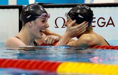 US swimmers Missy Franklin, left, and teammate Elizabeth Beisel celebrate after their first and third place finishes in the women's 200-meter backstroke final on Friday, Day 7 of the 2012 Olympics.