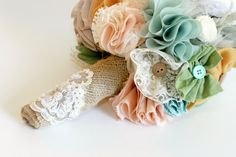 Custom Bridal Bouquet- Shabby Chic- beautiful assorted handmade fabric flowers with rustic burlap. $180.00, via Etsy.