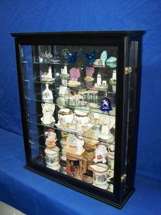 Items similar to Black Wall or Tabletop Curio Cabinet Display for Collectibles on Etsy Wall Curio Cabinet, Curio Cabinets, Display Cabinets, Ogee Edge, Cabinet Dimensions, Hummel Figurines, Wall Boxes, Table Top Display, Black Walls