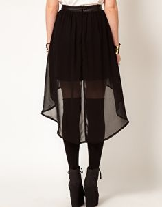 Asymmetrical black skirt with tights