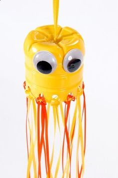 Hanging Jellyfish Tuesday, 10 July 2012  Monday Funday: Monogrammed Antiqued Phot... | Main | Web Wednesday: Apple Barrel Wind Chimes  Tuesday Tutorial: Kids Decor Hanging Jellyfish - yellow acrylic paint, Water bottle, Sponge brush, Hole puncher, yellow and orange ribbon, Two large wiggle eyes, scissors, craft glue