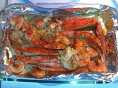 Garlic Butter Baked Crab Legs...serve family style in dish you baked these in with warm bread to sop up the buttery goodness!