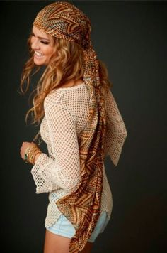 Carefree modern hippie fashion scarf and boho chic open weave crochet top for a fun music festival allure.