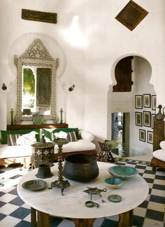 A collection of various 12th century Persian turquoise dishes are displayed in a room at Aziyade, a 19th century orientalist fantasy in Provence. Photographed for World of Interiors by Jean-Francoise Jaussaud