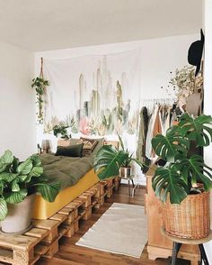 50 Dreamy Boho Bedroom Decorating Ideas - The wood-pallet bed has the uber-relaxed attitude of the emerging artist, while the plethora of plantlife keeps this Boho palace alive and thriving. Budget Bedroom, Bedroom Ideas, Bed Ideas, Diy Bedroom, Bedroom Designs, Bedroom Furniture, Bedroom Corner, Wood Bedroom, Bedroom Chair