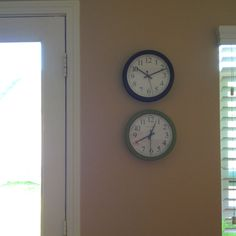 Deployment clocks — one with your time, the other with your deployed Marine's time.