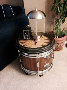 Repurposed bass drum clock table, for more unique musical gifts and art visit us at:  www.musicasartbysarah.etsy.com