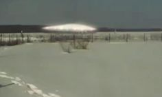 The clip, filmed in the remote Irkutsk region of Siberia appears to show a UFO and five aliens walking about in the snow.