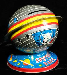 A 1958 tin decorated bank made to honor the Soviet launch of a dog, Laika, into space aboard Sputnik II Antique Metal, Antique Toys, Retro Toys, Vintage Toys, Kitsch, Atomic Decor, Space Toys, Baby Boomer, Exploration