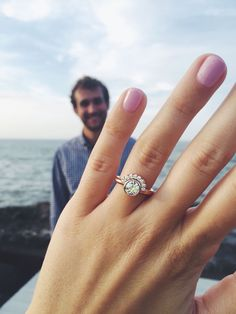 """My beautiful custom-made rose gold engagement ring that my handsome fiancé designed! The main diamond belonged to my grandma and on the back of the band is a small blue diamond for my """"something blue"""""""