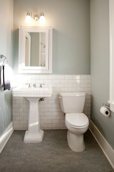 Traditional Powder Room with Built-in bookshelf, White subway tile, Concrete flo. Traditional Powder Room with Built-in bookshelf, White subway tile Room Tiles, Bathroom Floor Tiles, Downstairs Bathroom, Wall Tile, Bungalow Bathroom, Paint Bathroom, Neutral Bathroom, Bathroom Mirrors, Design Bathroom