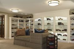 Antique toy collection gallery in a contemporary family room (photo-2011 house remodel, Eden Prairie, MN via Houzz) (Interior Design: Maureen Haggerty of mint, Inc.)