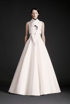 Dramatic white gown with sculptural bodice detail; futuristic fashion elegance // Gareth Pugh Spring 2015
