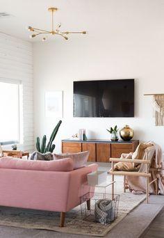 Midcentury inspired living room design with plenty of brass and pops of pink | Living Room Inspiration | Scandinavian Boho Decor | Vintage Revivals