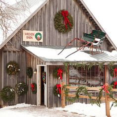 """Getting in the spirit.  Just looks like Christmas.  At the Wreath Barn, visitors shop for holiday knickknacks, watch craftsmen cut wooden ornaments with a jigsaw and chat with evergreen artisan Jody Durham. An assistant bank manager, Jody reserves one week of vacation time every year to craft wreaths for Dull's. """"It's like therapy; it gets you in the Christmas spirit,"""" she says."""