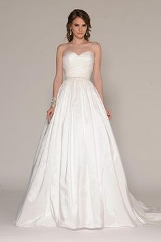 Wedding gown by Eugenia Couture.