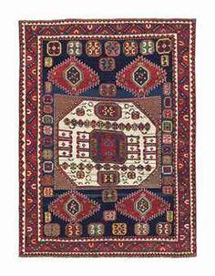 An antique Kazak Karachopf rug -   approximately 7ft.5in. x 5ft.7in.(226cm. x 170cm.)