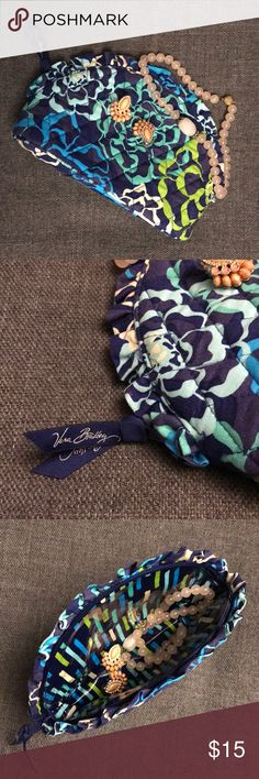 Vera Bradley Make Up Bag Lightly used Vera Bradley Make Up Bag. Clean, no stains, no rips. Smoke free home. Earrings and necklace not included in sale. Measures 8.5 long and 6 inches from arch to bottom. Vera Bradley Bags Cosmetic Bags & Cases