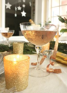 New Year's Eve is around the corner! Today I've put together my dream New Years' Eve tablescape by using some of my favorite vintage heirlooms and some new sparkly accents. Champagne (or sparkling grape juice) is mandatory!