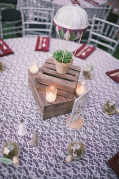 WEDDING IDEA: Hot Air Balloon Centerpieces - DIY.... http://blog.basicgrey.com/?p=3531  These take some TLC when making, but damn are they cute! Instead of candy like the tutorial had, I took clay pots, covered them with burlap string w/ my handy dandy glue gun, and put succulents in them. The crates were purchased from Michaels and aged by my sister.