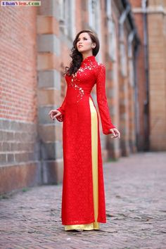 Vietnamese ao dai (traditional). Oh I LOVE this one!! Lace sleeves go with my lace theme. This is the one!