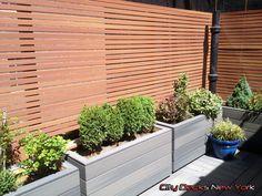 Composite Thin Slat Fence & Planter Boxes By City Decks New York, LLC http://www.citydecksny.com