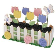 It's Growing Season - It's Growing Season and a batch of cookies has popped up in your garden. Each bloom is attached to a lollipop stick so it can stand tall when inserted in your Long Loaf cake.