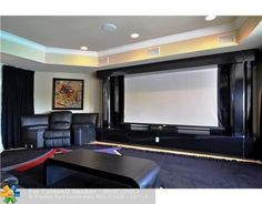 A modern home theater.  Fort Lauderdale, FL $7,400,000