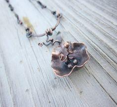 handmade artisan jewelry. rustic modern flower necklace