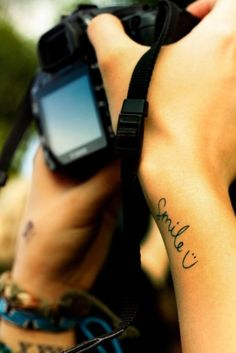 I love the idea of this tattoo phrase and the placement .. It would always be ready to cheer u up all the time!